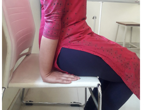 Dynamic Sitting Exercise versus Spinal Extension Exercise on Pain from Mechanical Low Back Pain